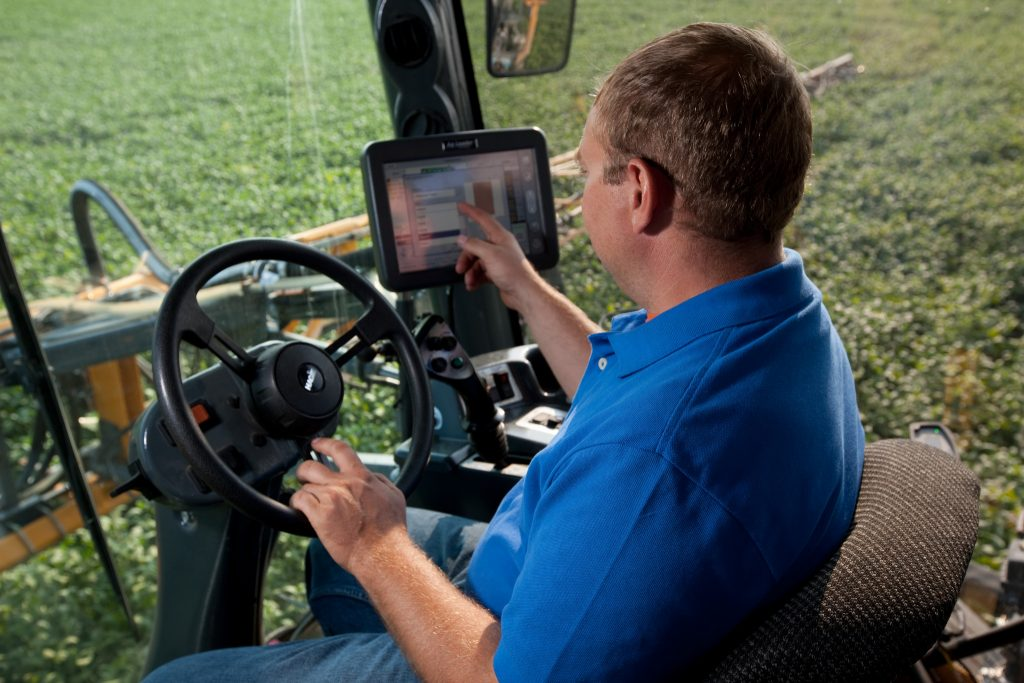 Farmer using precision technology in his tractor.