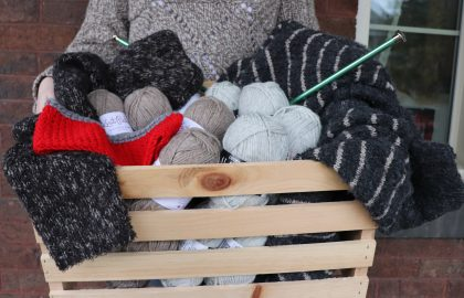 Box of yarn and wool products.