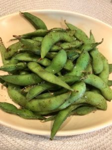 A bowl of spicy edamame.