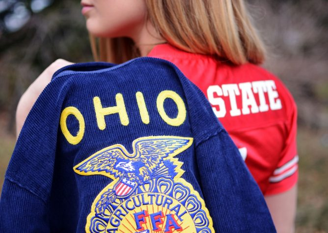 Ohio State student holds her FFA jacket over her shoulder.