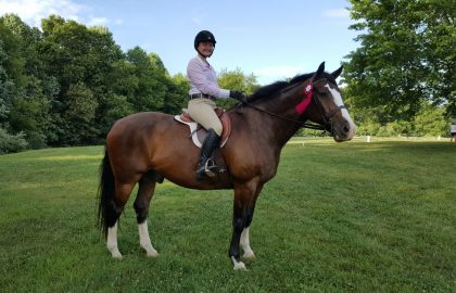 Mary Kate on a horse at her internship in Virginia.