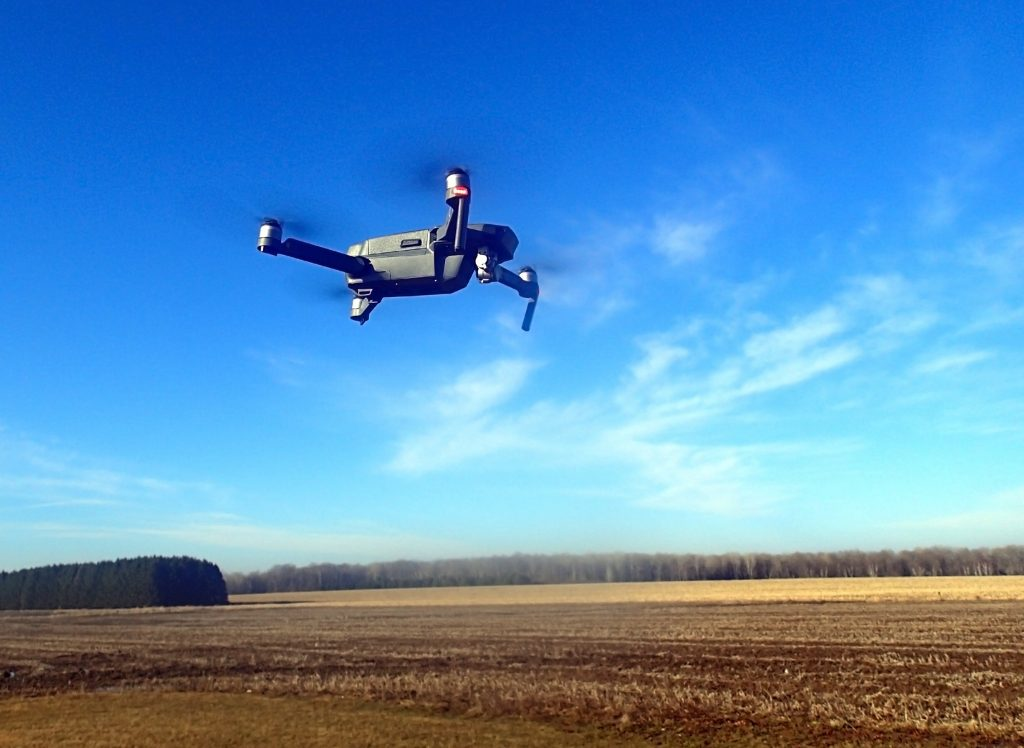 A drone flying over a farm field.