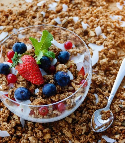 Granola with berries, yogurt, coconut and mint.