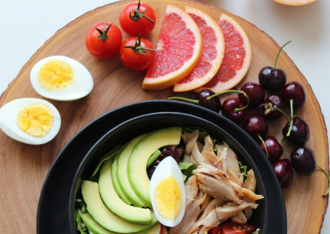 High-protein salad with grapefruit, cherries and tomatoes on the side.