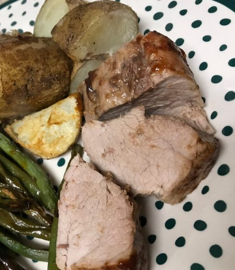 Pork tenderloin made with Ohio-raised ingredients and sides of green beans and roasted potatoes.