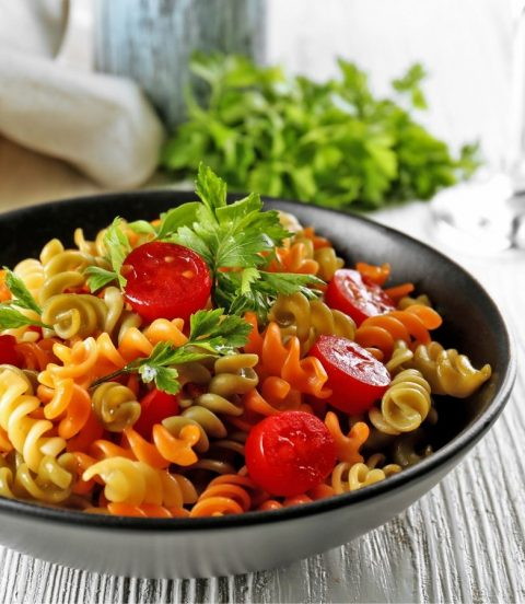 Colorful bowl of fresh pasta salad.